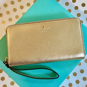 Kate Spade Gold Wristlet for wallet and cellphone